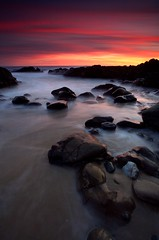Otherworldly (Nick Carver Photography) Tags: ocean california ca travel winter sunset sea usa cloud beach nature water rock vertical clouds landscape outdoors coast landscapes us rocks pacific nick boulders carver southerncalifornia orangecounty lagunabeach nickcarver ncpfineartprint