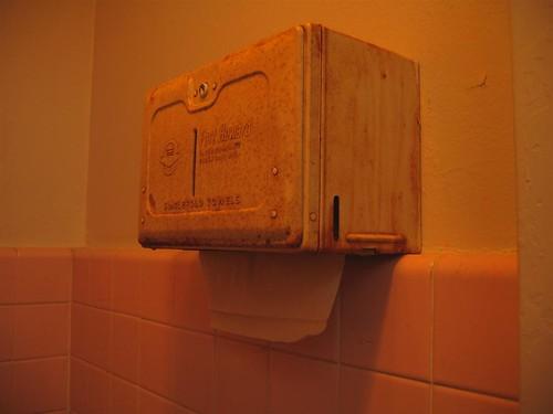 Rusted Fort Howard paper towel dispenser
