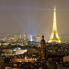 The Eiffel Tower is lighting Paris (jver64) Tags: paris france eiffeltower toureiffel grandpalais parisbynight gustaveeiffel canon40d eglisedelasaintetrinite hotelcarltons lightedparis