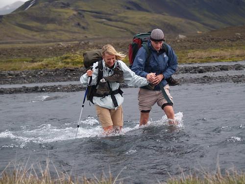 P7124922 Pernille and Ulrik crossing ice cold river at Landmannalaugar trek, Iceland