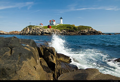Cape Neddick Light (VickerMonkee) Tags: summer vacation lighthouse water fence landscape coast rocks i5 maine explore shore nubblelight capeneddicklight yorkbeachmaine explorefrontpage redbubble tokinaaf1116mmf28 atx116prodx on9112008