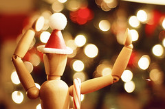 What fun it is to laugh and sing (Ana Santos) Tags: christmas mannequin project bokeh sketching christmastree candycane 2008 santahat puffballs mannequinproject hbw 25daysofchristmas anasantosphotography bokehphotography