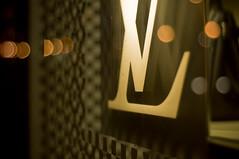 L to the V. (Chairman Ting) Tags: vancouver 50mm nikon nightlights granvillest f18 lv louisvuitton d40 nightdisplay carsonting