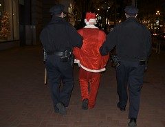 Santa gets arrested - Santacon 2008 (Steve Rhodes) Tags: sf sanfrancisco california santa christmas ca xmas shopping december santas market saturday police dec buy powell santaclaus santacon uniforms capitalism sell pranks society 2008 13th consumerism shoppers arrest culturejamming powellst sfpd sfist rampage marketst hohoho cacophony santarchy badsanta officers consumers saintnick santarampage powellandmarket powellmarket cacophonysociety december13 santaconsf sanfranciscopolice badsantas december13th december2008 121308 santacon2008 santacon08 mostwonderfultimeoftheyear santarchy08 upcoming:event=1378643 santarchy2008 sfsanta08 santaconsf2008 arrestingsanta saturdaythe13th santarchysf08 santarchysf2008 santaconsf08