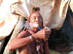 Himba lady smoking (Sallyrango) Tags: africa portrait people african culture tribal safari tribes afrika tribe ethnic namibia tribo himba afrique ethnology tribu namibie tribus ethnie