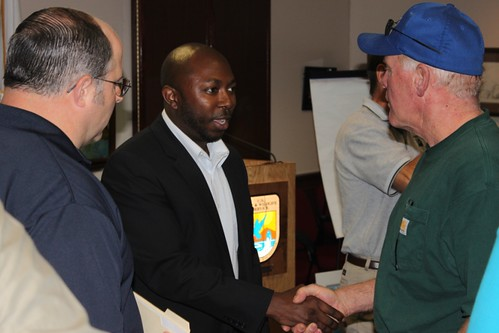 Acting Deputy Under Secretary Karis Gutter (center) meets with producers affected by the Missouri River flooding