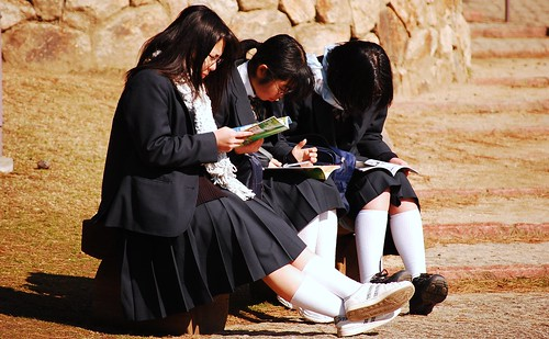 School girls reading the guide