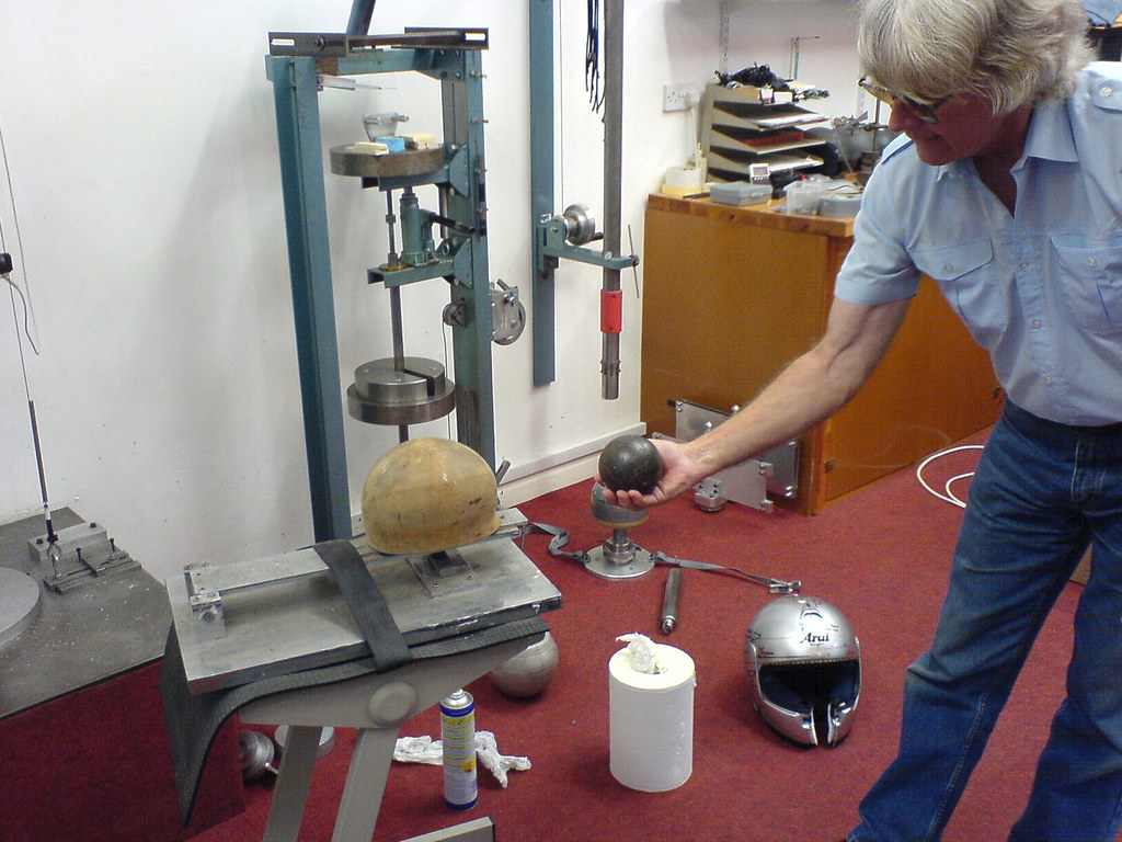 Brian Walker holding the original testing sphere, which was dropped loose onto the top of helmets(!) This test equipment is the original BS test rig..