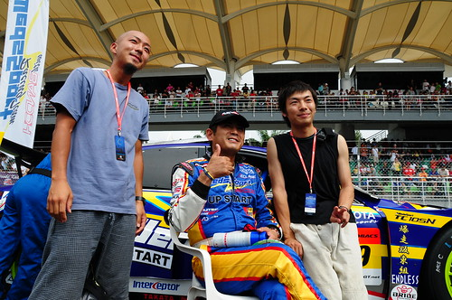 A race driver and fans (Nikon 18-200mm VR sample photos taken at the Super GT 2008 race, Sepang)