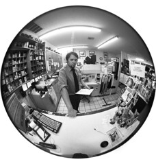Mr. Ogden (insert dramatic echo here) (Zeb Andrews) Tags: bw portraits portland distorted candid tx stjohns coworkers fisheye kodaktrix pdx circular bluemoon onceinabluemoon camerastores bluemooncamera zebandrews zebandrewsphotography