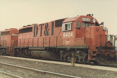 Former Detroit, Toledo & Ironton Railroad EMD road switchers idling at the Grand Trunk Western RR Elsdon Yard. ( Gone.) Chicago Illinois. June 1984.