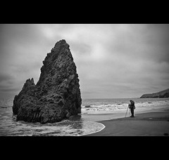 The lone photographer (ccmonty) Tags: ocean bw beach water rock clouds photographer pacific aaron marinheadlands jesters rodeobeach