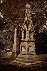 Cemetery monument (Mary Susan Smith) Tags: monument cemetery graveyard sepia headstone superhero cabbagetown necropolis bigmomma challengeyouwinner 3waychallengewinner cychallengewinner novotedesafio photofaceoffwinner photofaceoffgoldmedal pfogold achallengeforyou herowinner