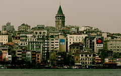 The Galata Tower and Istanbul City (aanintercon) Tags: city blue sea vacation portrait building tower water canon turkey shot trkiye 85mm istanbul traveling holliday galata turki freephotos 40d