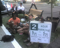 People enjoy a temporary park set up in a parking space on a San Francisco Street in 2006 as part of the Park(ing) event created by REBAR Group.