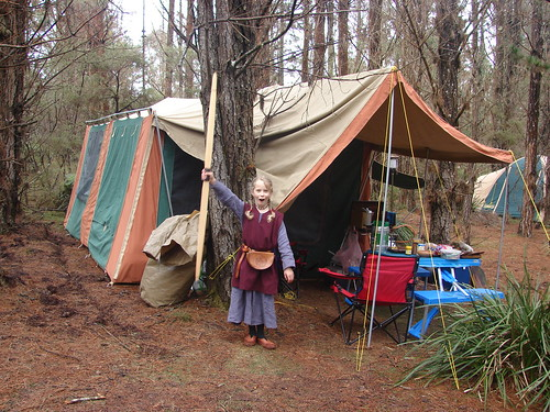 Caitlin with her bow outside our tent