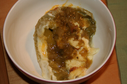 Chiles Rellenos topped with salsa