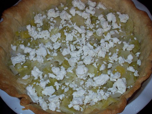 layering leeks and goat cheese in tart