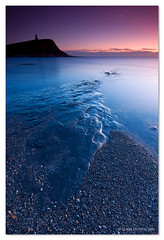 (Claire Hutton) Tags: ocean uk longexposure blue winter sunset sea england moon seascape cold southwest water silhouette rock landscape coast purple south hill wideangle pebbles cliffs dorset folly kimmeridge ledges jurassiccoast clavelltower