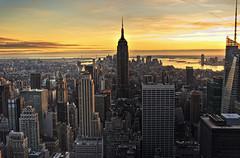 Sunset on NY (belthelem) Tags: nyc sunset usa newyork skyline nikon manhattan kingkong empirestate topoftherock nuevayork eeuu 10faves imagepoetry d80 25faves algopararecordar oracope