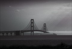 rolling fog (Through My Eyes, (astra.amara)) Tags: bridge blackandwhite mist lake fog boat ship michigan ghost foggy lakemichigan lakehuron mackinacbridge freighter mackinac mackinaw disappear ghostship dirtyjobs