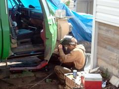 Bradley welding on his truck
