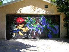 Little Angus Sparypainter (See El Photo) Tags: california street city urban 15fav streetart color art acdc wall graffiti paint grafiti graf horns urbanart melrose 100views redcap spraypaint fav graff devilhorns garagedoor grafite 1f faved 涂鸦 111v1f граффити seeelphoto melroseca littleangus chrislaskaris 落書きգրաֆիտի
