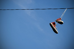 converse (kim.taylor.) Tags: blue sky clouds wire shoes converse powerline yellowsprings redconverse vinyetting