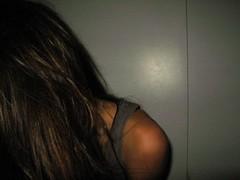 Camera Shy (youneverknowphotography) Tags: camera selfportrait wall closet dark hair grey lowlight tank shy shoulder timid