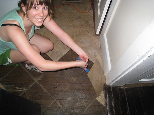 Katy Pulling Up Tiles