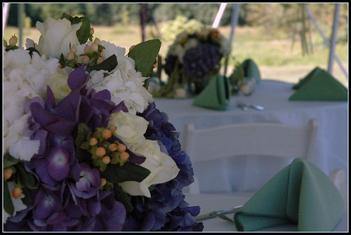 They included cream roses purple hydrangea and green amaranthus