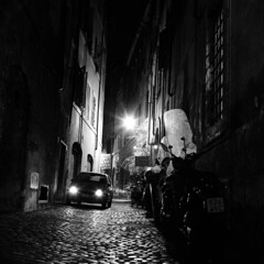 "Rome (Peter Gutierrez) Tags: photo europe european italy italian italia italiano lazio rome roman roma romano quadrato urbano città vie via street streets urban city day daytime latin capital building buildings architecture people night time nighttime nocturne nocturnal nacht notte noche nuit evening dark light shadow black white bw nero e bianco square format peter gutierrez ""peter gutierrez"" cobble cobbles cobblestone cobblestones stone stones sidewalk pavement public film photograph photography"