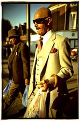 Chap (Jane Hoskyn) Tags: portrait people man london film sunglasses shopping lca crossprocessed kodak candid strangers streetphotography slidefilm moustache suit 35mmfilm bags e17 waistcoat walthamstow chap dapper kodakelitechrome walkbyshootings e6processedasc41