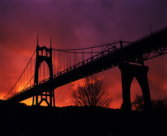 St Johns Bridge, a sunset and a show (Zeb Andrews) Tags: bridge sunset urban film architecture oregon portland xpro crossprocessed xprocess colorful cityscape silhouettes pacificnorthwest pdx stjohnsbridge suspensionbridges pentax6x7 bluemoon