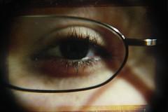 An Eye for an Eye (Day 126) (Mark 8:34 Photography) Tags: world portrait woman black macro eye texture face look female self canon dark lens rebel glasses glare eyelashes overlay stare eyelash spectacles spec underexposed foureyes xsi gandi 4eyes noeye