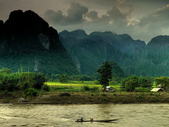 Crossing the Nam Song river (Bn) Tags: laos topf100 topf200 vangvieng paddyfields rainyseason topf400 100faves 200faves vientianeprovince namsongriver mywinners top300 300faves 400faves viangchan ridepaddies boostertag xayohriversidecaf steerlimestonecliffs greenpaddyfields bansabaibungalows flickrsfinest100faves vroemmm boatcrossingtheriver klikddd crossingthenamsongriver