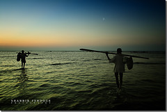 At World's End (Shabbir Ferdous) Tags: ocean blue sunset sky silhouette clouds fisherman photographer stmartin bangladesh ef2470mmf28lusm bangladeshi canoneos5d shabbirferdous wwwshabbirferdouscom shabbirferdouscom
