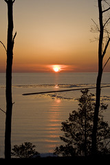 Sunset Over Lake Huron at Goderich (Conrad Kuiper) Tags: sunset sky lake beach water landscape scenery 1001nights goderich bej abigfave platinumphoto aplusphoto flickrenvy naturessilhouettes goldstaraward gnneniyisithebestofday theselectbest dragondaggerphoto superstarthebest