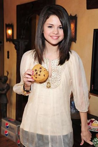 Selena Gomez eating a Cookie! by PureMusicLover