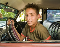 Young Cuban Driver, Green Eyes, Pinar del Rio, Cuba (Marie-Marthe Gagnon) Tags: boy vacation portrait car portraits kid eyes holidays gorgeous profile cuba 15 tourists castro fidel second vinales rockclimbing 1000 pinardelrio 15f cubavacation mariegagnon mariemarthegagnon cubavacations cubanvacation