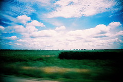 Central Illinois (kevin dooley) Tags: blue sky blur green film clouds analog 35mm landscape moving illinois lomo xpro lomography crossprocessed saturated slim cloudy farm central wide picture driveby farmland best explore creativecommons autor notdigital viv vivitar ultra alright adn accordeon alot agains fromcarwindow acustom amature alcohal apon ackward accidently apperance assitant altho attendent absense actualy abscence addres acheivement aslo assocation vivitarultrawideslim auxillary acheive vivitarultrawideandslim adition aplusphoto ahev acording adquire alledge alege alwyas abilties abritrary accomadate acuracy agreing anuhwere attedent ammend