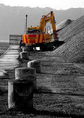 Digger at port penrhyn (rhianwhit) Tags: blackandwhite colour port bangor machine caterpillar machinery gravel digger wfc selective gwynedd bollards selectivecolour penrhyn welshflickrcymru portpenrhyn