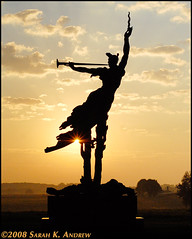 Louisiana Monument at Dawn: Gettysburg, PA (Rock and Racehorses) Tags: park morning friends sunset orange history monument silhouette angel sunrise 50mm star louisiana glow pennsylvania silhouettes trumpet explore pa gettysburg civilwar national flare battlefield burst monuments contrejour sculptor donalddelue louisianamonument artilleryman