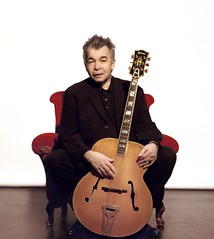 John Prine with his guitar