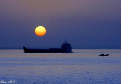 Boat in  a Quiet Sunset (Nouf Alkhamees) Tags: blue sunset sun yellow canon boat sigma alk nono  alkuwait  nouf        flickrestrellas alkhamees   noufalkhamees
