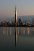 Burj Khalifa , Dubai (Ahmad Al Zarouni) Tags: reflection water canon eos construction dubai side under uae khalifa 5d و من في burj skycraper برج ما على دبي عند خليفة غيوم شروق خلفية الشمس الماء 5photosaday انعكاس زاوية زال كانون قيد مميزة الانشاء البرج امارة فجرا