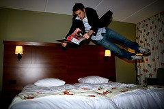 Reading causes elevating thoughts (joelfrijhoff) Tags: fall hotel fly jump bed funny arnhem float oosterbeek bilderberg canoneos30d bedjump joelfrijhoff wwwjoelfrijhoffcom