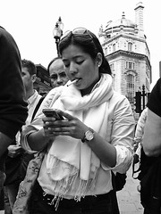 Prying eyes (ro_nya) Tags: urban london candid crowd streetphotography smoking snoopy nosy texting ronya pryingeyes ricohgx200