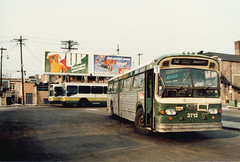 New and old at the CTA West 63rd Place bus terminal. March 1986.