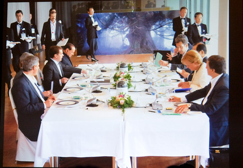 G8 Summit with Amano Photo in Background